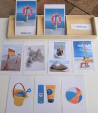 laminated cards of various beach related items on a table