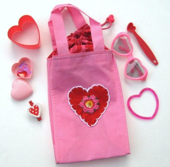 Pink embroidered bag with hearts on it
